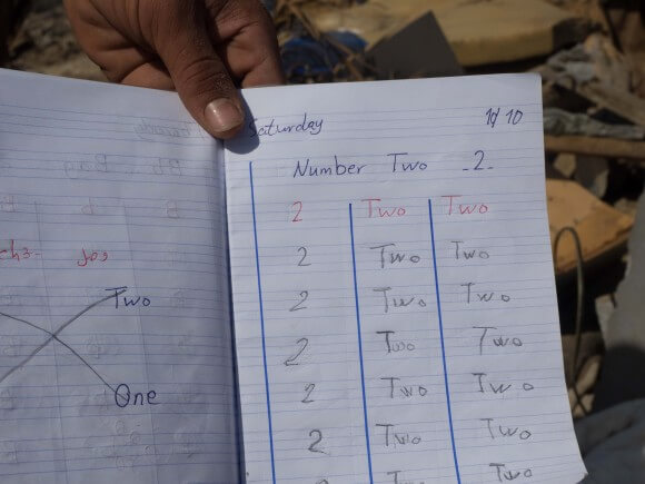 English class homework found in a small backpack amid the rubble of Hassan home, Gaza, photo by Dan Cohen