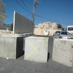 Israel's latest security measures place roadblocks, a wall, and a checkpoint in the Jabel Mukaber neighborhood of East Jerusalem. (Photo: Allison Deger)