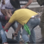 Screen shot of a video filmed by journalist Ahmad Jarghoun where undercover Israeli forces shoot and detain a Palestinian protesters during a demonstration outside of Ramallah, October 7, 2015.