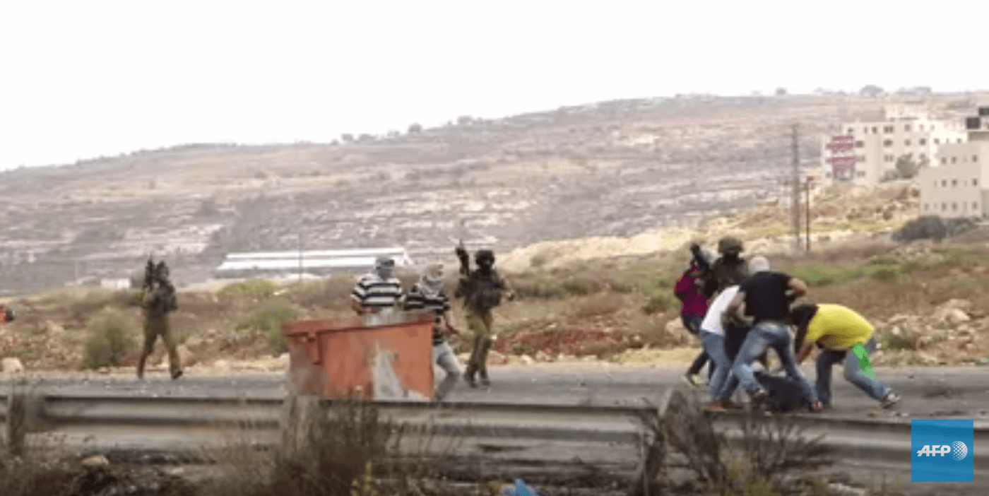 Screenshot of a video filmed by journalist Ahmad Jarghoun, where undercover Israeli forces are seen shooting and detaining a Palestinian protester outside of Ramallah, October 7, 2015.