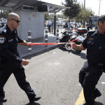 Israeli police cordon off the site where a Palestinian stabbed two Israelis Thursday afternoon, critically injuring one, in East Jerusalem. (Photo: Anadolu Agency/Getty Images)