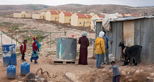 Um al-Kheir, with Israel's illegal Carmel settlement in the background. Photo: ActiveStills / Keren Manor