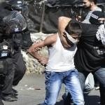 Israeli undercover police arrest a 10-year old Palestinian child on October 24, 2014. (Photo: Salih Zeki Fazlıoğlu/Anadolu Agency)