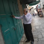 Palestinian shop owner closes his store in the Muslim quarter of East Jerusalem following orders from Israeli police. (Photo: Allison Deger)