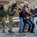 Undercover Israeli soldiers detain a Palestinian protester after assaulting him near Ramallah.  (Photo: Reuters)