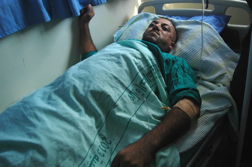 Palestinian journalist Salah Zayyad, 35, recuperates in a Ramallah hospital after Israeli forces shot him in the abdomen at a demonstration near Qalandia checkpoint in the West Bank, October 6, 2015. (Photo: Allison Deger)