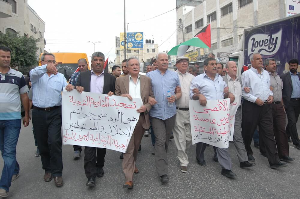 Palestinians in Qalandia march toward an Israeli checkpoint in a day of protests across the West Bank, October 6, 2015. (Photo: Allison Deger)