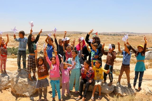"Susiya children with ""pinwheels for peace"" Photo: CPT Palestine"