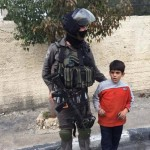 Israeli soldier detaining 6-year-old Abdullah Youssef. (Photo: Maan News)