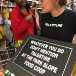 Sarah Wellington of We Will Not Be Silent makes her position clear at the Park Slope Food Coop. Photo credit Trey Pentecost