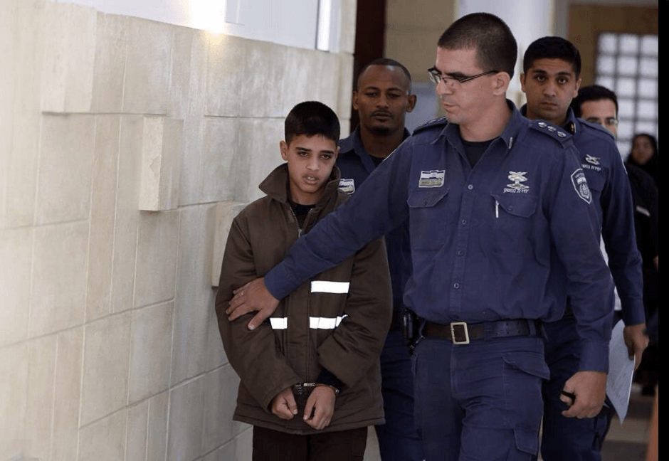 Ahmad Manasra being led by Israeli authorities in a detention facility (Source: Twitter)