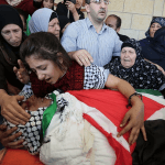 Palestinians mourn over the body of 23-years-old Muhammad Shemasina, killed by Israeli soldiers on October, during his funeral ceremony in Jerusalem, on November 02, 2015. (Photo: Anadolu Agency/Getty Images)