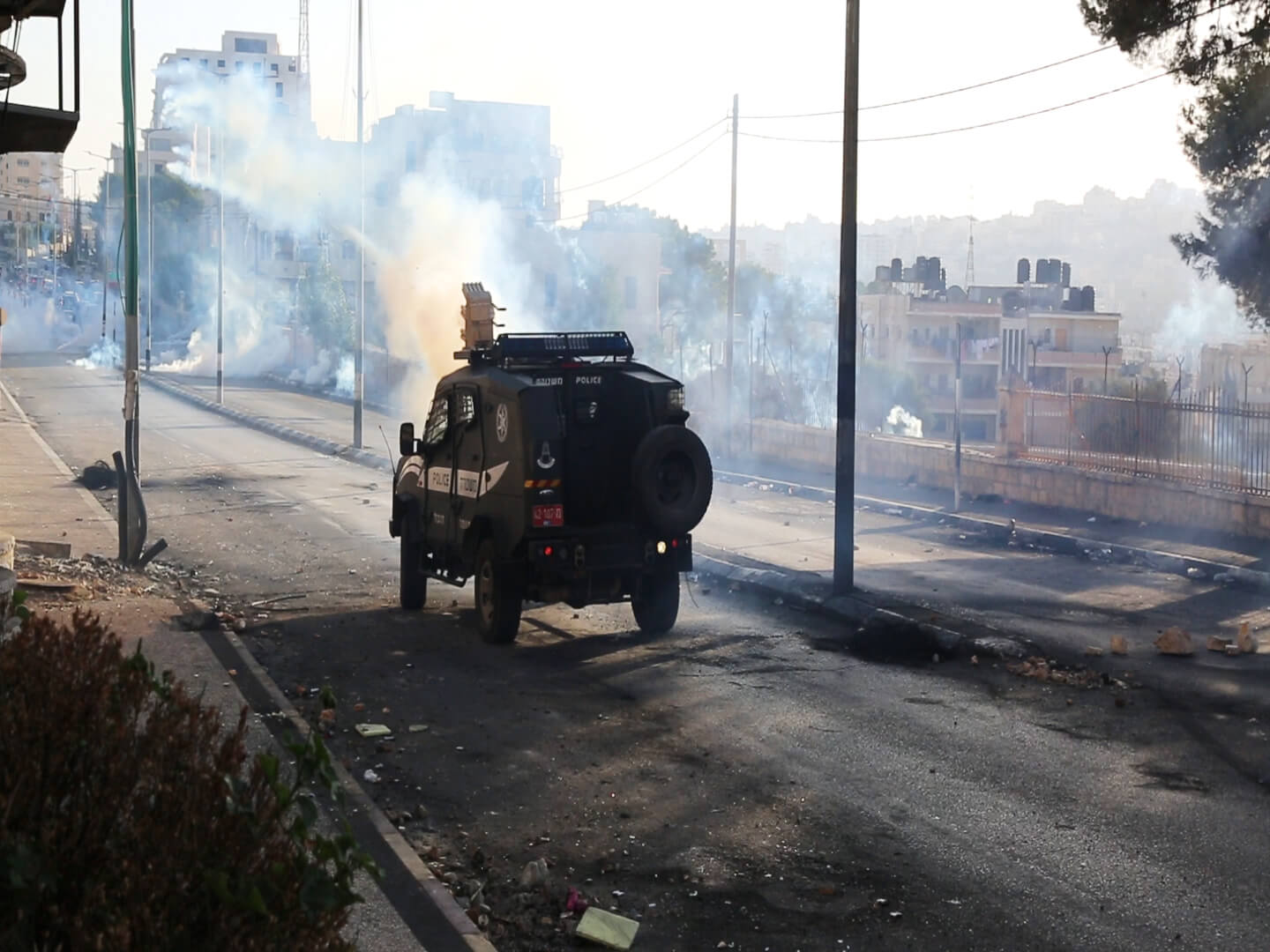 Israeli army jeeps have the capability of shooting off up to 60 tear gas canisters at once without reloading. (Photo: Abed al Qaisi)
