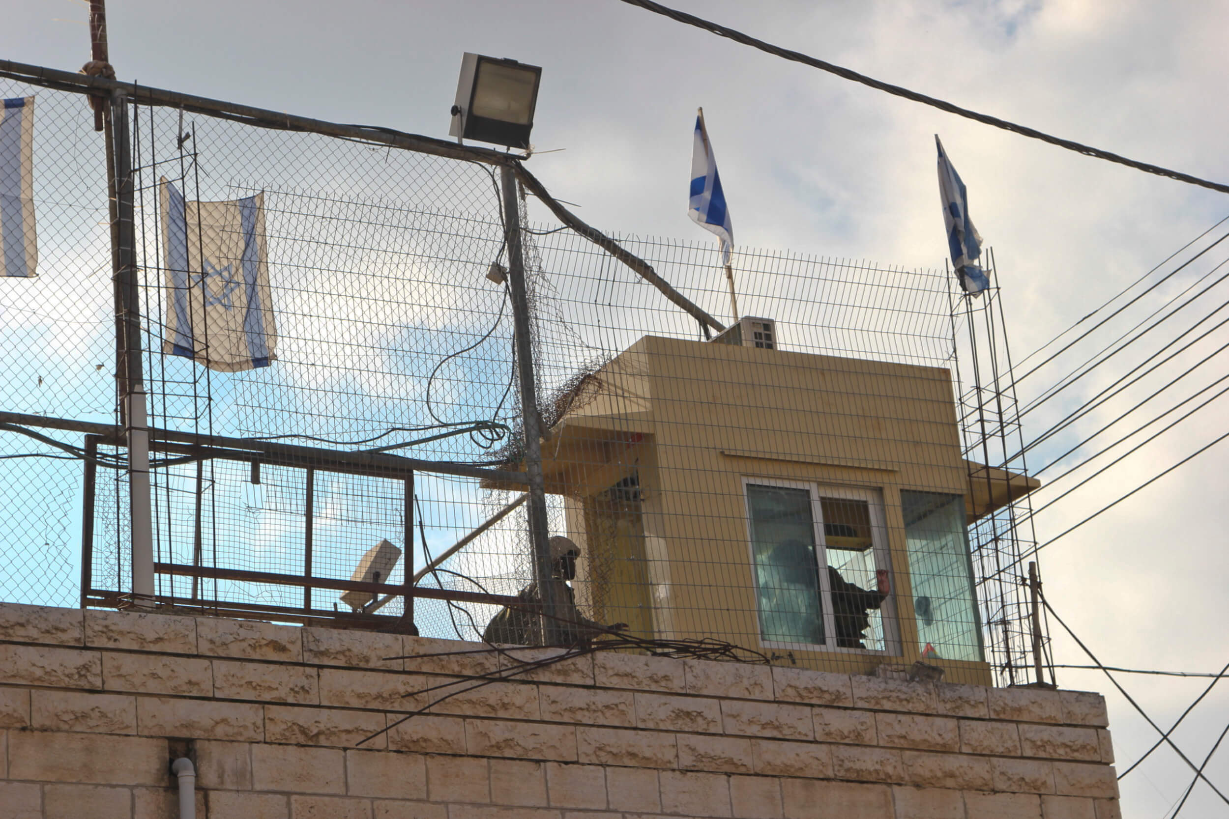 Israeli soldiers in watchtower overlooking Hebron. (Photo: Megan Hanna)