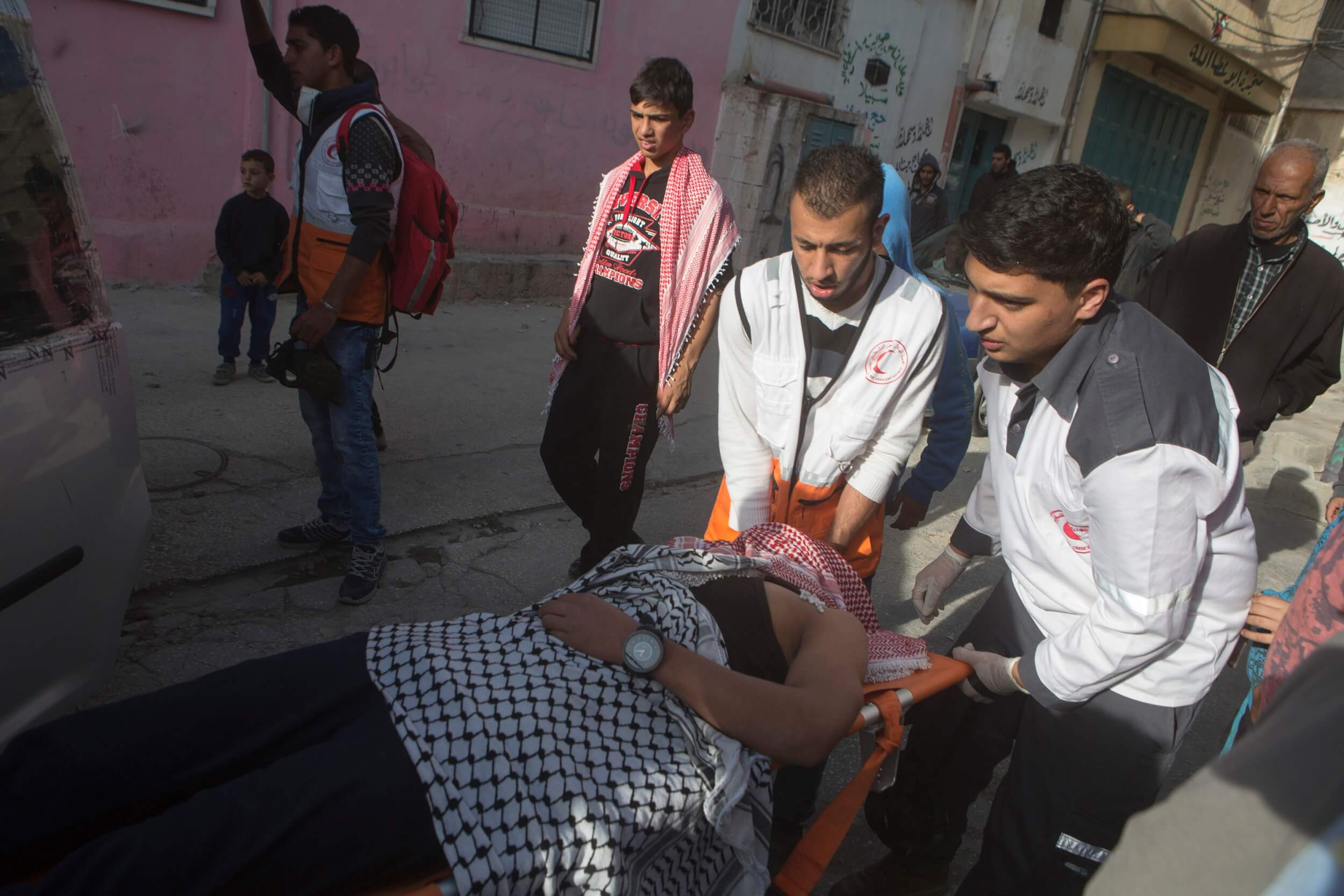 Injury to Palestinian demonstrator, photo by Anne Paq