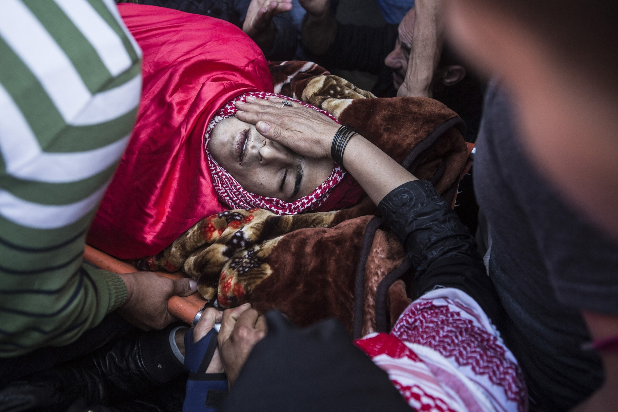 Khalid Mahmoud al-Jawabreh's mother touches him for the last time