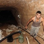 A worker inside a Gaza tunnel which was partially destroyed by Egypt. (Photo: Isra Saleh El-Namy)