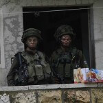 Israeli soldiers inside of the Hebron-based Youth Against Settlements office/living quarters, Saturday November 7, 2015. (Photo: Youth Against Settlements)