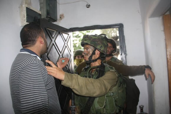Israeli soldiers entering the Youth Against Settlements' house in Hebron early Saturday morning. (Photo: Youth Against Settlements)