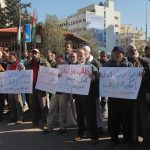 Palestinians take part in a protest organized by employees of former Palestinian government demanding their salaries to be paid, in front of the headquarters of the Council of Ministers in Gaza city on January 20, 2015. Some 40,000 civil servants employed by the Hamas government stopped receiving salaries soon after the formation of the Palestinian unity government in June. (Photo: Ashraf Amra/ APA Images)