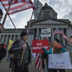 Pro & con refugee demonstrators face off at Washington State  Capitol (photo: Seattle Times)