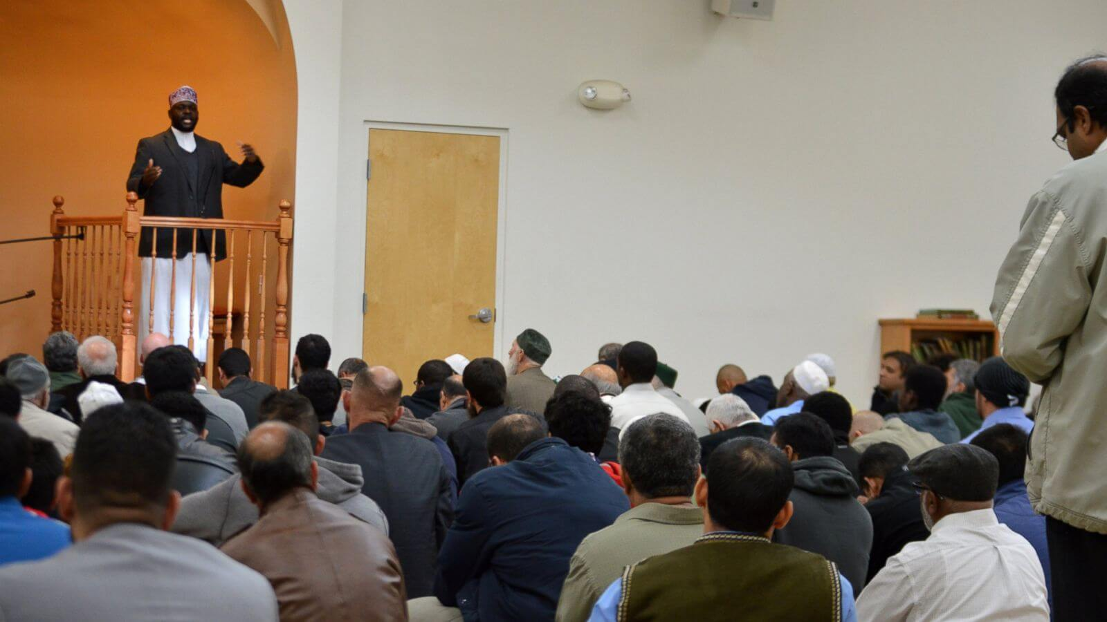 "Imam Shafi Abdul Aziz, left, of the the Islamic Center of New Mexico in Albuquerque, speaks on the importance of tolerance during afternoon prayer Friday, Dec. 11, 2015. A coalition from Albuquerque's Christian and Jewish communities presented the Albuquerque mosque dozens of ""letters of support"" after GOP presidential candidate Donald Trump advocated the U.S. place a moratorium on Muslim immigration. (AP Photo/Russell Contreras)"