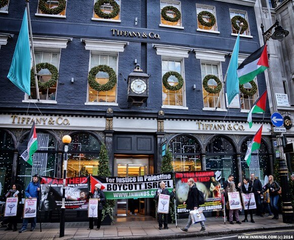 Human rights activists protest outside Tiffany's on Old Bond Street in London at Christmas in 2014. (Photo: www.inminds.com)