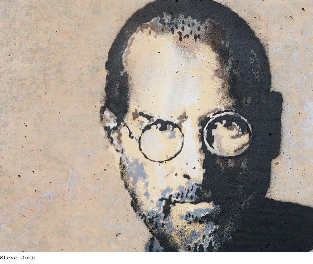 """Close up of Steve Jobs face in """"the son of a migrant from Syria"""" -Artwork by Banksy"""