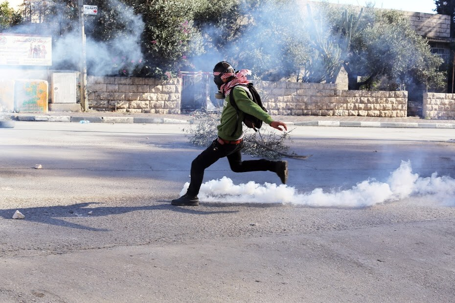 Protester kicks tear gas canister, Bethlehem
