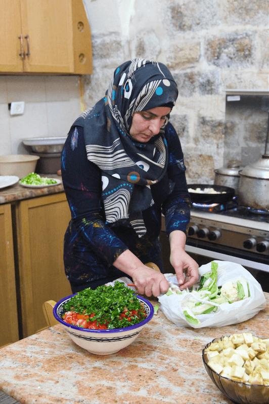 A female employee preparing ingredients. (Photo: Megan Hanna)