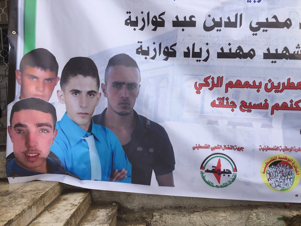 Poster of four young men from occupied Palestinian village, Sa'ir, killed on one day in January. Their names were Ahmad Kawazba, Alaa Abed Kawazba, Muhannad Kawazba, and Khalil al-Shalalda (Photo: Adam Horowitz)