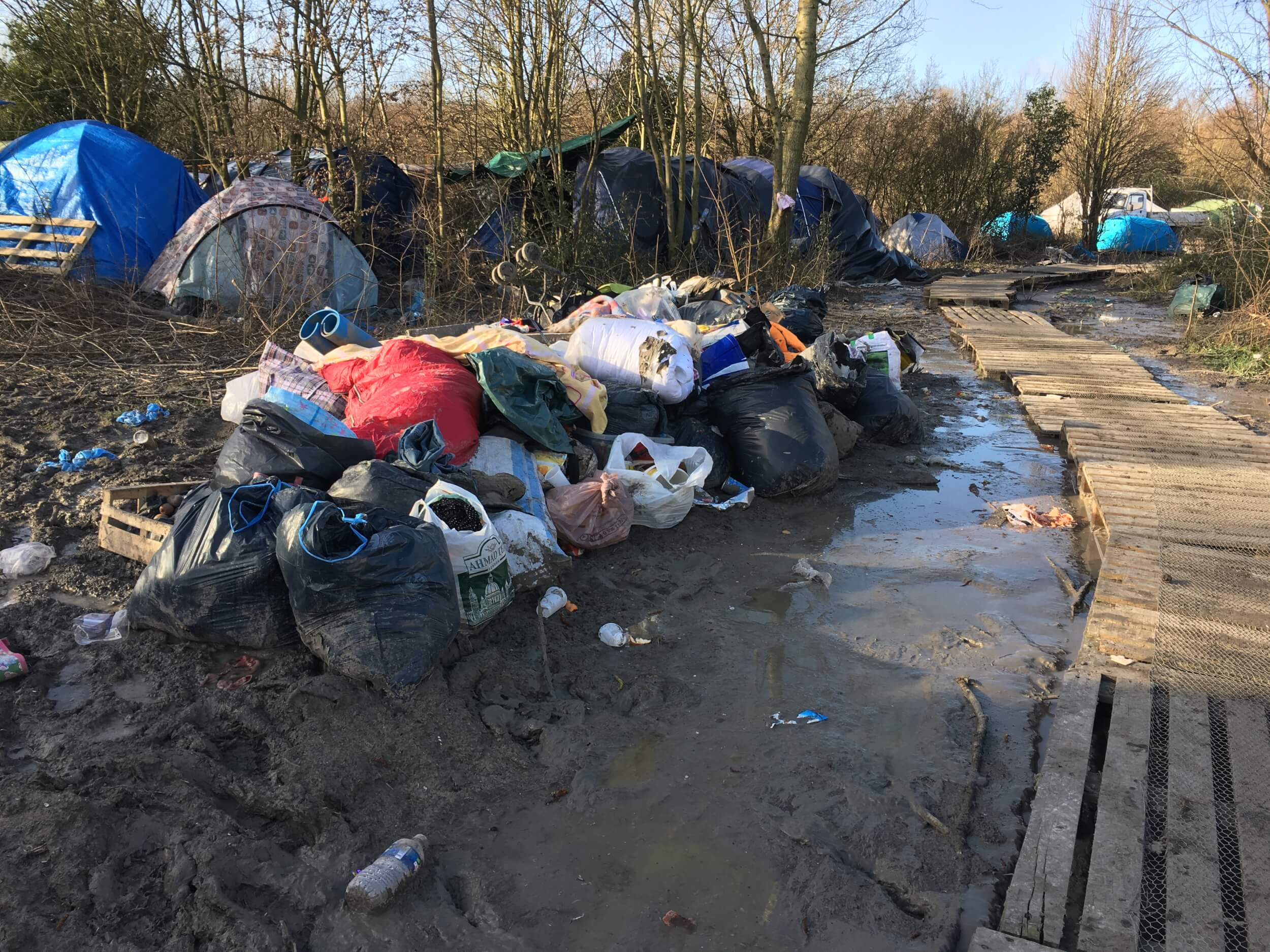 """Donations provided by locals can sometimes be seen going to waste, as volunteer groups here have no access to warehouse space. Something Marni Bosanquet from Aid Box Convoy calls """"a massive problem."""" (Photo: Katherine Schwartz)"""