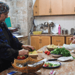 Women prepare ingredients in Beit al Karama kitchen. (Photo: Megan Hanna)