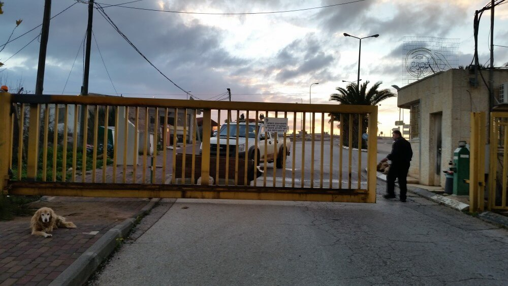 The gate of Ofra settlement closing the orthodox community for the Sabbath, Jan. 15, 2016 (Photo by Philip Weiss)