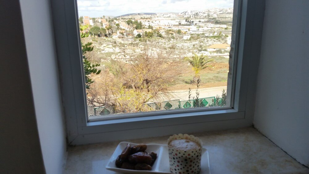Breakfast of dates and muffin in Ofra settlement
