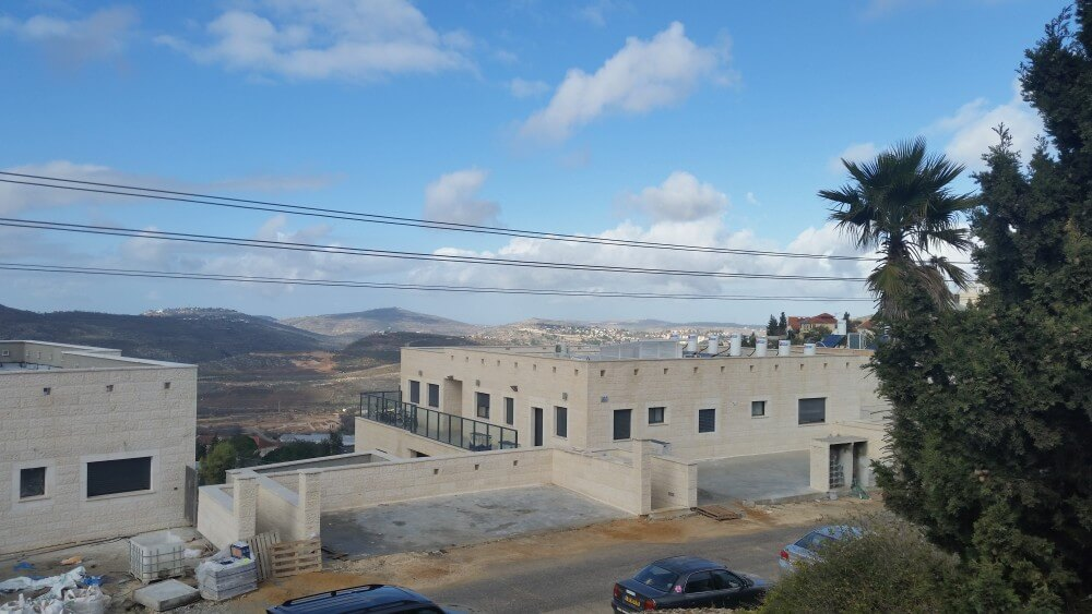From my window my settler host tells me we are looking at five settlements, Maale Levona, Givat Harel, Ariel, Eli, and in the foreground, Shiloh. (Photo: Philip Weiss)