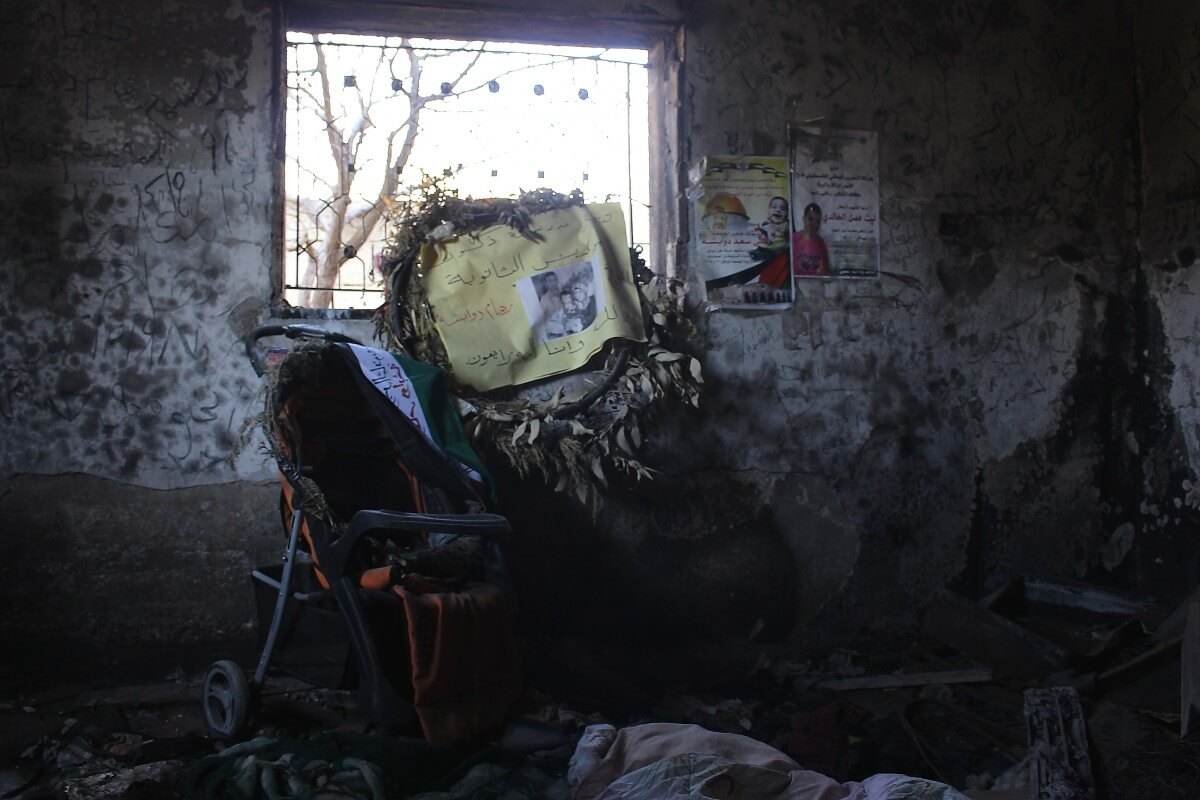 The burned out bedroom of the Dawabsha family home after extremist settlers firebombed the house, killing Riham, Sa'ad, and 18-month-old Ali Dawabsha. (Photo: Matthew Vickery)