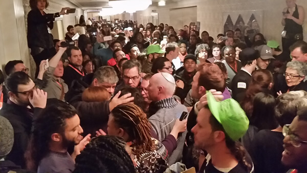 Protesters jam a hall outside reception for pro-Israel group at Creating Change, LGBTQ conference in Chicago, Jan. 23, photo by Andy Thayer of Gay Liberation Network
