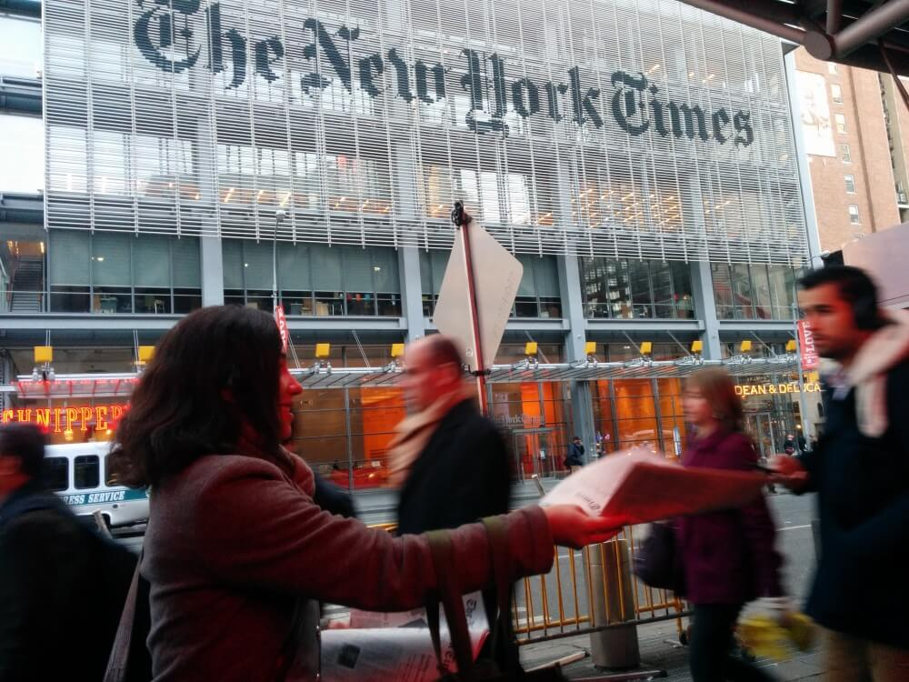 New York Times supplement being distributed near the New York Time headquarters.