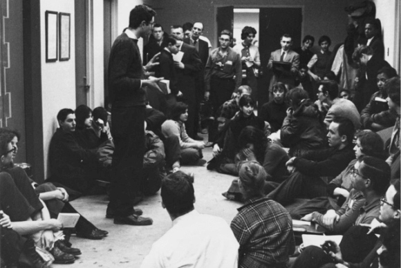 Circa 1962: Bernie Sanders leads a sit in of CORE activists inside the University of Chicago administration building protesting discrimination against blacks in university owned housing. Photographed by Danny Lyon
