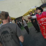 Left-wing and right-wing Israelis outside of an event in Tel Aviv on Friday where 40 human rights groups protested the Knesset NGO transparency bill. (Photo: Allison Deger)