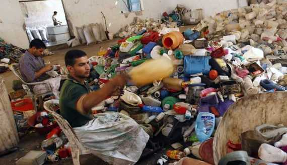 Palestinian laborers sort plastic containers before they are recycled in a factory in Abasan in the southern Gaza Strip (Photo: REUTERS/Ibraheem Abu Mustafa)