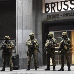 Soldiers stand guard in front of the central train station in Brussels. (Photo: Emmanuel Dunand/AFP/Getty Images)