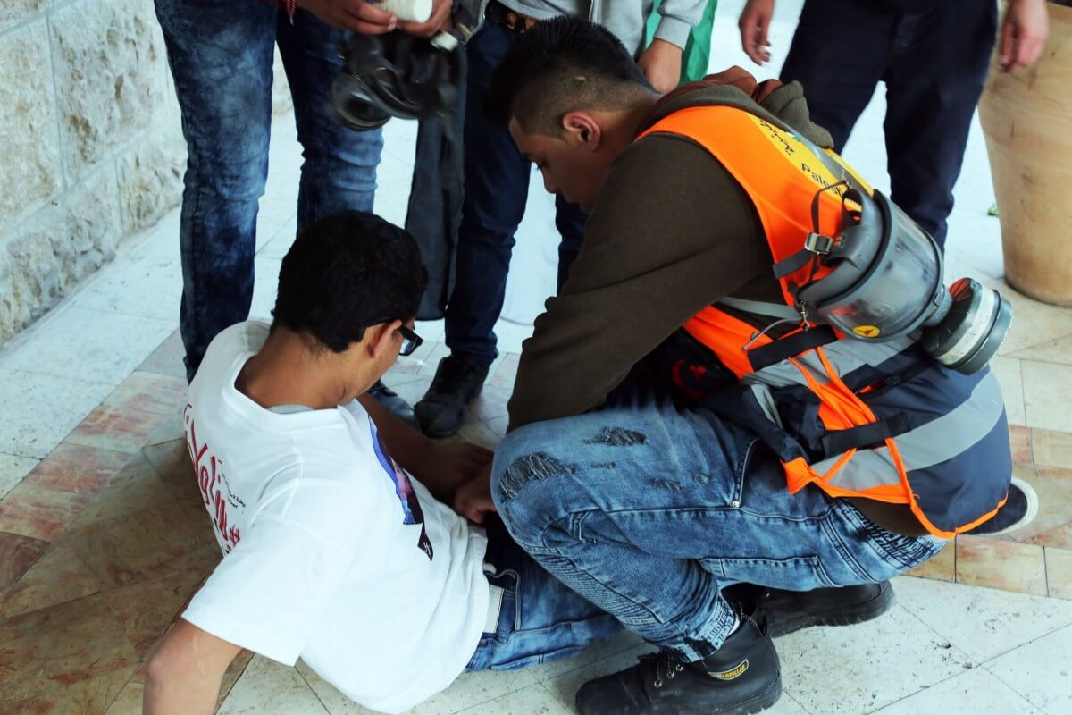 Medics rushed to one young man who was shot with a rubber-coated steel bullet in the leg. (Photo: Abed al Qaisi/Mondoweiss)