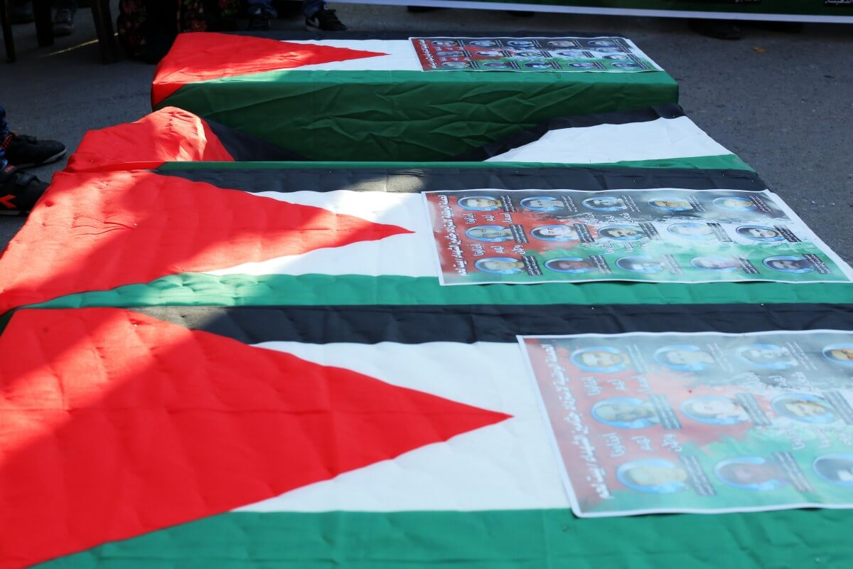 Protesters carried fake coffins draped in Palestinian flags, marching toward Israel's separation wall. (Photo: Abed al Qaisi/Mondoweiss)