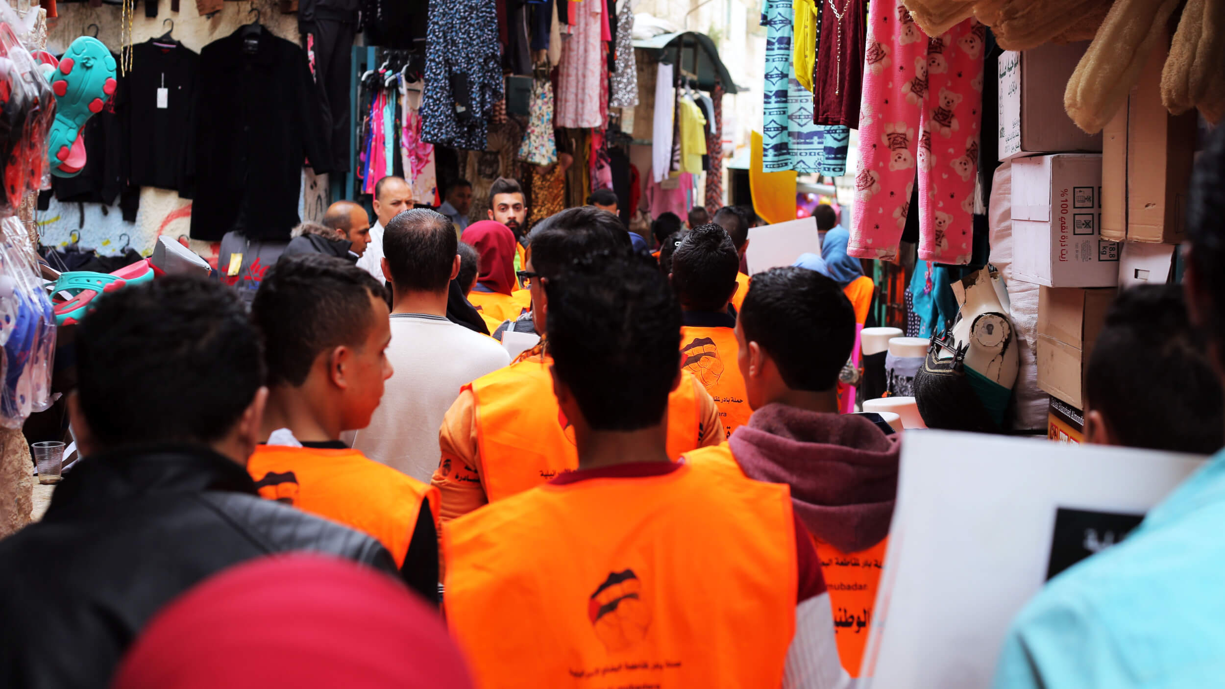 Marchers made their way from open streets to Bethlehem's winding alleyways in the city's suk, or traditional marketplace. (Photo: Abed al Qaisi)