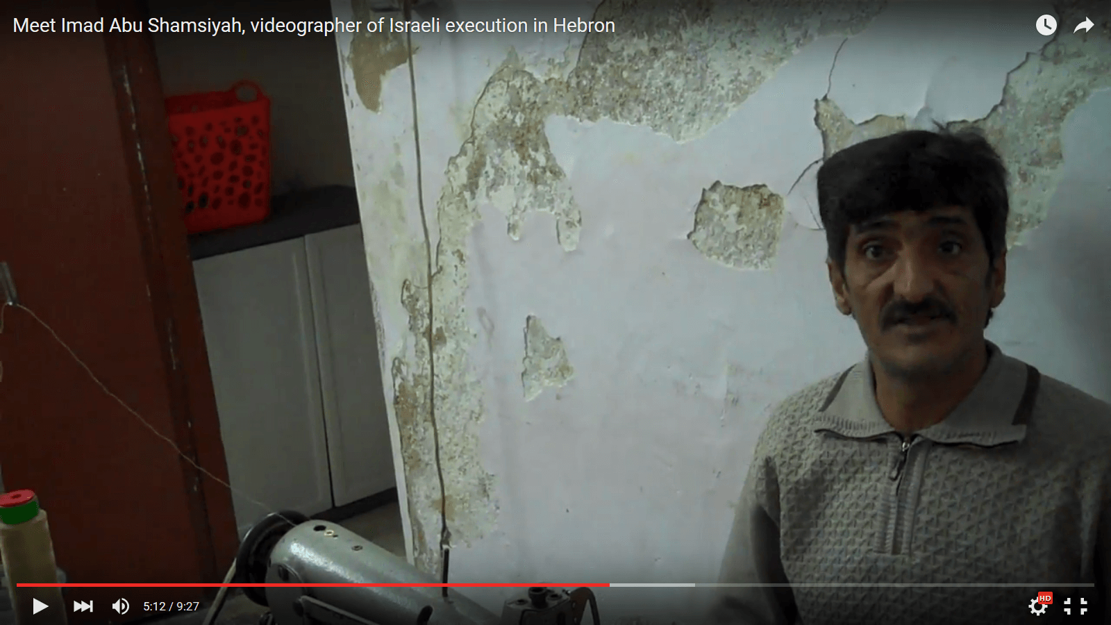 Imad Abu Shamsiya at his sewing machine