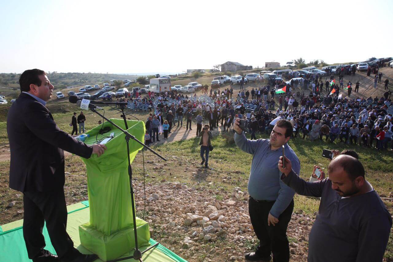 Head of the Joint List Ayman Odeh addresses protesters in the Negev town of Umm el-Hieran for Land Day commemoration. (Photo: Joint List)
