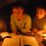 Children study by candlelight due to the power crisis in Gaza, 2009. (Photo: Mohammed Asad)