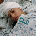 Hatim abu Mayyala after being shot in head by Israeli forces on way to school. Note star of David on the hospital blanket